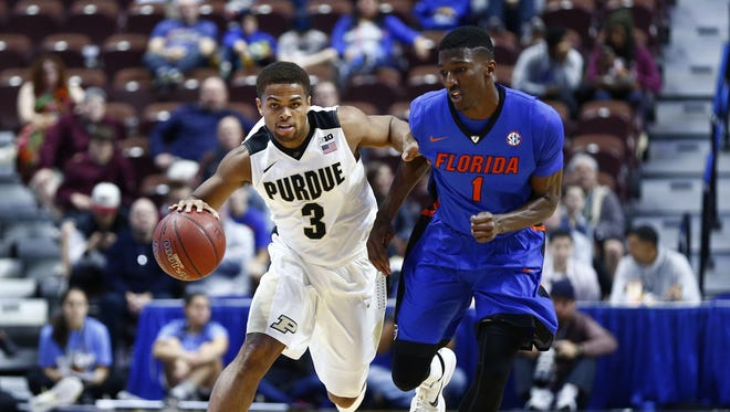 Purdue guard P.J. Thompson dribbles the ball as Florida guard DeVon Walker defends during the first half at Mohegan Sun Arena.