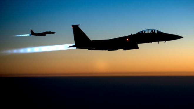 A pair of U.S. F-15E Strike Eagles fly over northern Iraq, after conducting airstrikes in Syria. U.S.-led coalition warplanes bombed oil installations and other facilities in territory controlled by Islamic State militants in eastern Syria  on Sept. 23, 2014.
