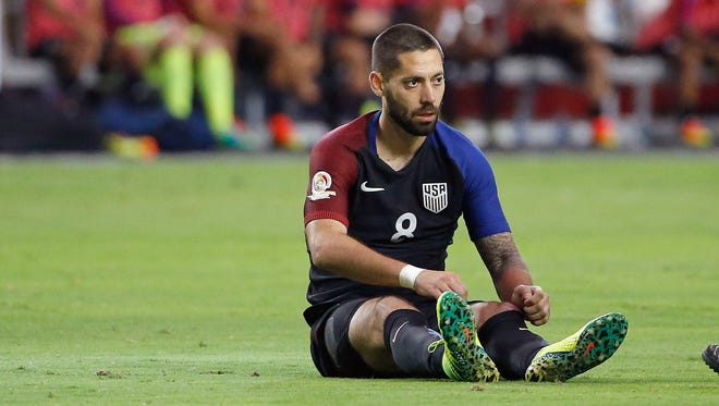 Clint Dempsey sits on the pitch after a turnover during the second half Saturday.