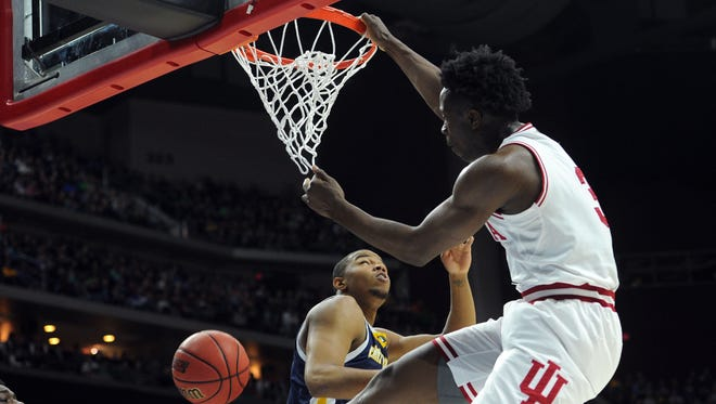 Indiana Hoosiers forward OG Anunoby (3) dunks the ball over Chattanooga Mocs forward Chuck Ester (0) during the second half in the first round of the 2016 NCAA Tournament at Wells Fargo Arena.