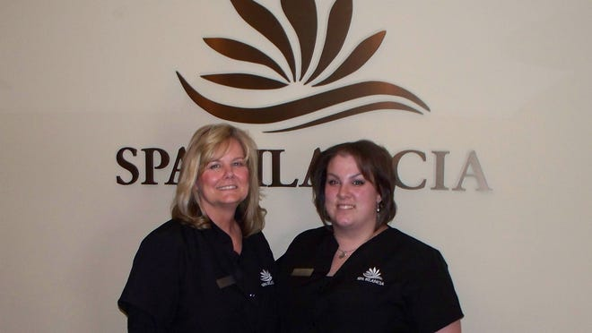 Owner Colleen Beer and massage therapist/nail technician Soraya Wagner help relieve customers' stress at Spa Bilancia, 59 Second St. in Coralville.