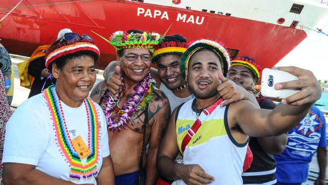 """Tony Piailug, second from left, son of the late traditional navigator Pius """"Mau"""" Piailug, poses for a selfie with others during a vessel naming ceremony at the Port Authority of Guam on  Sept. 16. The shipping company Matson named one of its vessels, """"Papa Mau,"""" after the man who is sometimes referred as the """"Micronesia's grand master navigator""""."""