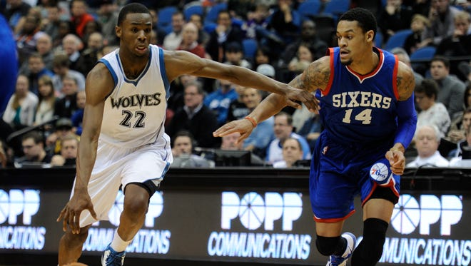 Philadelphia 76ers guard K.J. McDaniels (14) defends against Minnesota Timberwolves forward Andrew Wiggins (22) in a recent game. Both are in the mix for NBA rookie of the year.