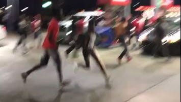 A still from video shared to social media of a shooting at a Montgomery gas station Sunday night.