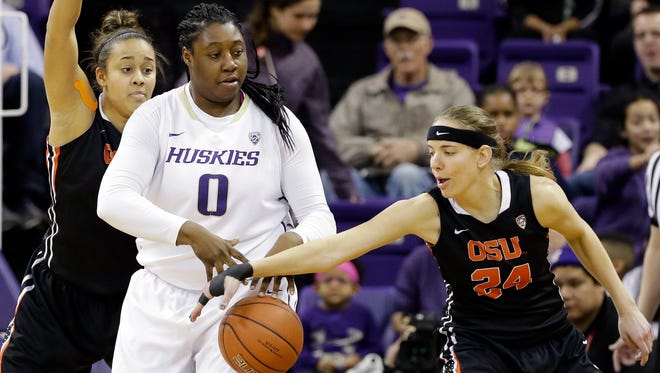 Oregon State's Sydney Wiese steals the ball from Washington's Chantel Osahor during a 2016 Pac-12 game in Seattle.