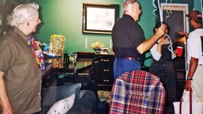 Lura Dean Richardson (left) smiles as she watches her husband Bobby Lee converse with Sadia and Owais Khan during Owais Khan's 30th birthday party in 2000.