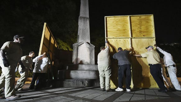 Birmingham city workers use plywood panels to cover