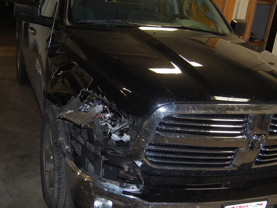 Photo of the truck's damaged front light.