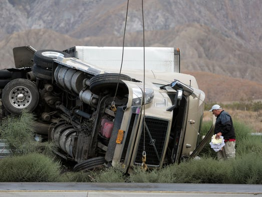 An overturned big-rig blocks multiple lanes on the West bound I-10 between Haugen Lehman Way and Main St. in Cabazon on Wednesday, August 20, 2014.