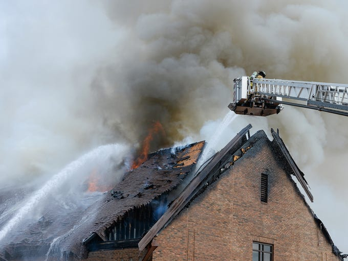 Fire crews fight a fire at Advent United Methodist