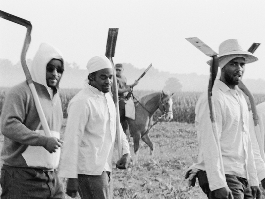 "Chandra McCormick, ""Men Going to Work in the Fields of Angola,"" 2004. Gelatin silver print."