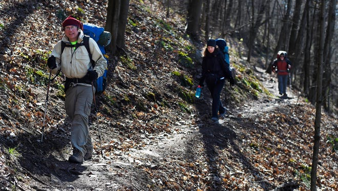 Hikers from left Landon Woodward, Irina Eftimie and Bill Schultz hike out after an overnight on the Appalachian Trail. The trio covered 16 miles in their two-day hike.