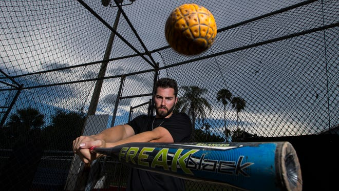 Bo Greenwell poses for a portrait in one of the batting cages at Mike Greenwell's Bat-a-Ball and Family Fun Park in Cape Coral. Bo is co-owner along with his brother Garrett.
