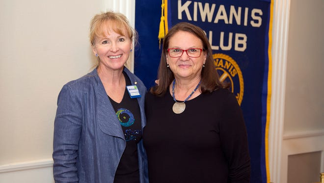 Becky Spargo (left), of the Kiwanis Club of Abilene, presented a $1,000 donation to Linda Egle, founder and executive director of Eternal Threads, at the club's May 24 meeting.