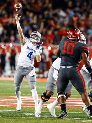 University of Memphis quarterback Riley Ferguson (middle) makes a pass against the University of Houston defense during second quarter action in Houston, Texas., Thursday, October 19, 2017.