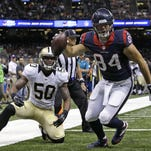Texans tight end Ryan Griffin, right, reacts after making a touchdown catch in front of Saints linebacker Stephone Anthony during a preseason game Sunday in New Orleans.