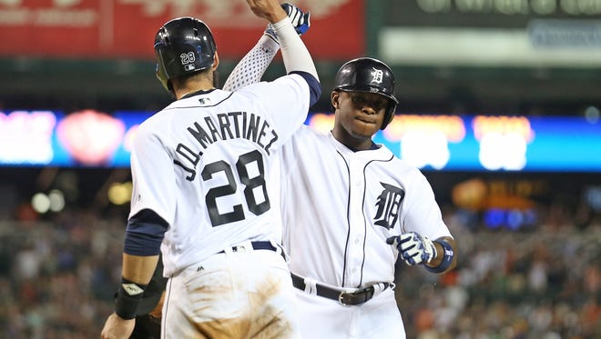 Tigers leftfielder Justin Upton celebrates after hitting a two-run home run to left field scoring teammate J.D. Martinez during the sixth inning of the  Tigers' 4-2 win Friday at Comerica Park.