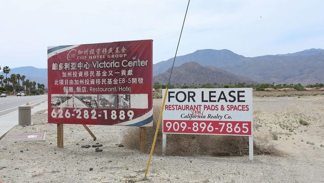 A sign promoting the Victoria Center advertises space for development near the southwest corner of Jefferson St. and Hwy 111 in La Quinta, April 7, 2017.
