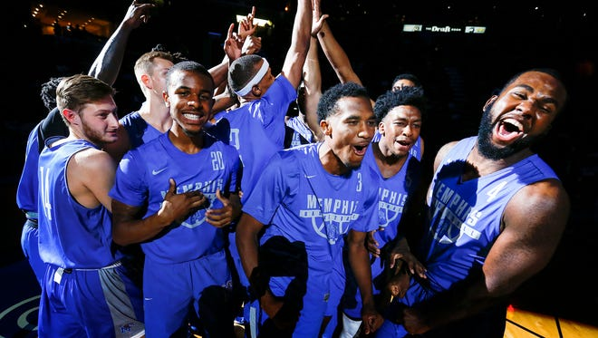 Tiger teammate celebrate with each other during Memphis Madness at the FedExForum Wednesday, Oct. 12, 2017.