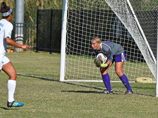 Northwestern State goalkeeper Alex Latham collects the ball in a game last season.