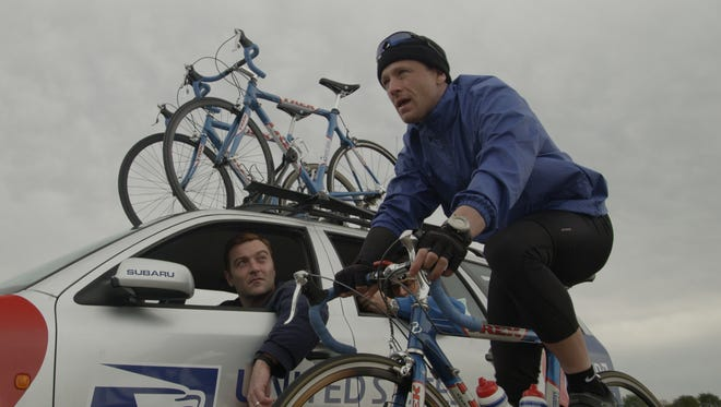 """Lee Pace as Bill Stapleton, left, and Ben Foster as Lance Armstrong in """"The Program."""""""