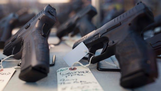 Handguns are for sale at a gun shop in Merrimack, N.H., on Nov. 5, 2016.
