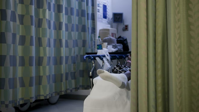 A patient waits in the emergency room of Cooper University Hospital, Camden.