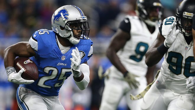 Lions running back Theo Riddick looks for room to run against the Jacksonville Jaguars in Sunday's win at Ford Field. The team rushed for 14 yards and is ranked 30th of 32 teams in the NFL in rushing.
