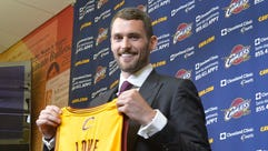 Aug 26, 2014; Independence, OH, USA; Cleveland Cavaliers player Kevin Love poses with his jersey at Cleveland Clinic Courts. Mandatory Credit: David Richard-USA TODAY Sports ORG XMIT: USATSI-188770 ORIG FILE ID:  20140826_ter_ar7_488.jpg