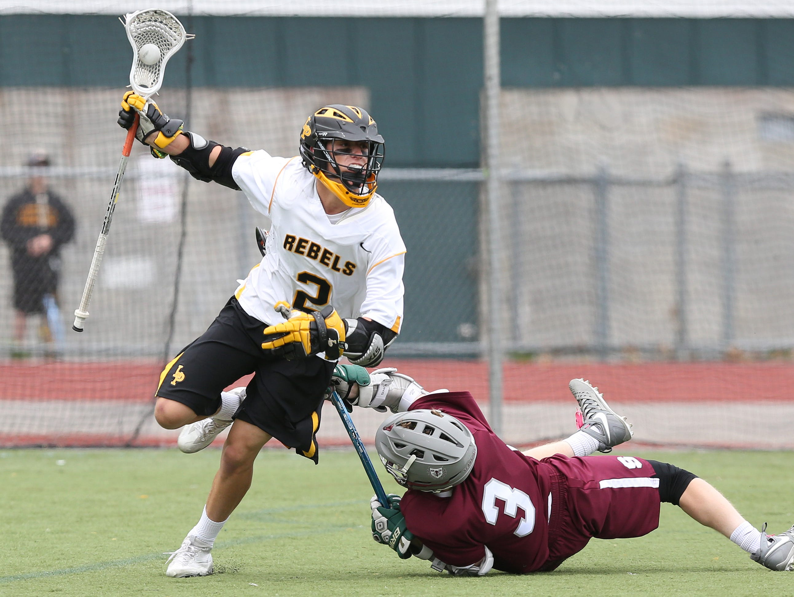 From left, Lakeland/Panas' Sean Makar (2) moves around Scarsdale's Sam Seltzer (3) during second half action in a Section 1 boys lacrosse playoff game at Lakeland High School in Shrub Oak May 21, 2016. Lakeland/Panas won the game 11-7.