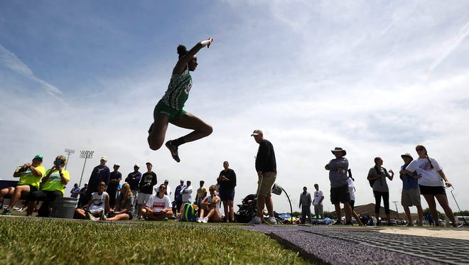 Breckenridge's Tori Karl soars into the pit in the girls long jump during the Region I-3A track meet on Friday, April 28, 2017, at Elmer Gray Stadium in Abilene. Karl finished second with a jump of 17-2.5 to qualify for the state meet.