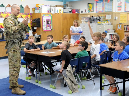 Chief Warrant Officer 2 Kyle Brantner of the California Army National Guard talks to a third-grade class at Big Springs School in Simi Valley about his experiences as a pilot. Last year, when the students were in second grade, they corresponded with Brantner while he was in Iraq.