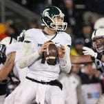Quarterback Connor Cook is hit after he throws a pass by Maryland defender Yannick Ngakoue (7) during the first half of MSU's game against Maryland on Nov. 14. Cook injured his shoulder on the play.