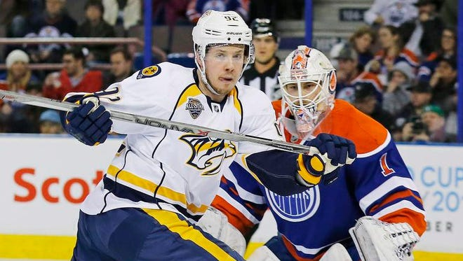 Predators forward Ryan Johansen looks for a rebound in front of Oilers goaltender Laurent Brossoit during the first period at Rexall Place.
