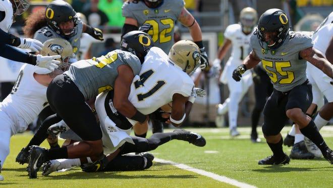 Sep 3, 2016; Eugene, OR, USA;  Oregon Ducks defensive lineman Eddie Heard (32) tackles UC Davis Aggies running back Joshua Kelley (41) in the first half at Autzen Stadium. Mandatory Credit: Scott Olmos-USA TODAY Sports
