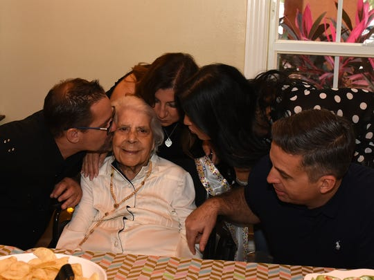 Elaine Saba, born in Jerusalem in 1913, is surrounded