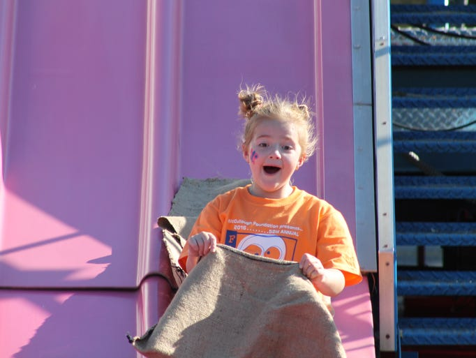 Students enjoy games and rides during the 52nd annual