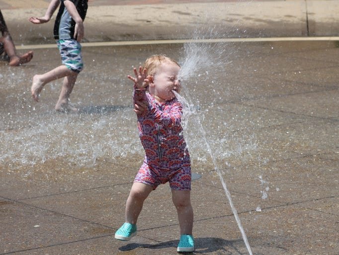Sydney Pail, 18 months, had so much fun splashing around