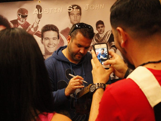 A fan snaps a photo of Austin St. John at while he