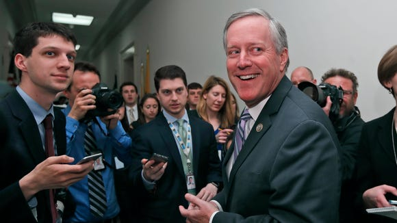 House Freedom Caucus Chairman Rep. Mark Meadows, R-N.C. smiles as he speaks with the media Thursday on Capitol Hill in Washington following a Freedom Caucus meeting. The week's debate over a replacement for the Affordable Care Act put a spotlight on Meadows and the group.