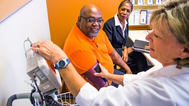 Nurse Linda Romaine, William Speed's, a U.S. Army veteran from Sun City, blood pressure Oct. 9, 2015, at the Northwest Veterans Affairs Health Care Clinic in Surprise.