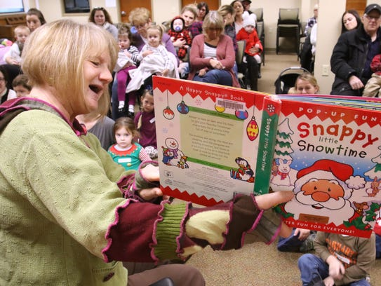 "Judy Becker, youth services assistant, reads ""Snappy"