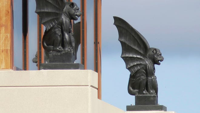 Gargoyles stand guard at Acuity's headquarters, Wednesday, September 27, 2017, in Sheboygan, Wis. The firm recently added the creatures to its million-square-foot office facility.