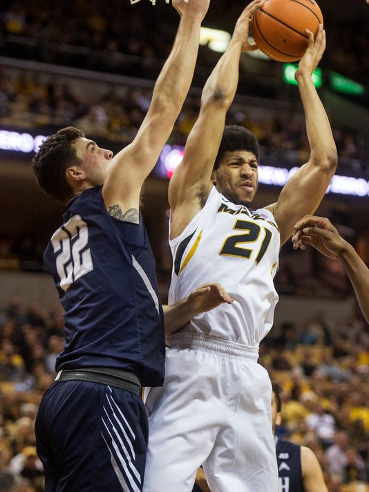 Missouri's Jordan Barnett, right, pulls down a rebound in front of North Florida's Trip Day, left, during the first half of an NCAA college basketball game Saturday, Dec. 16, 2017, in Columbia, Mo. (AP Photo/L.G. Patterson)