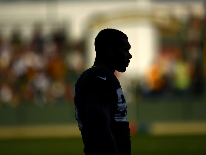 Green Bay Packers' Julius Peppers is silhouetted against the stands during training camp practice at Ray Nitschke Field on Monday, Aug. 4, 2014. Evan Siegle/Press-Gazette Media