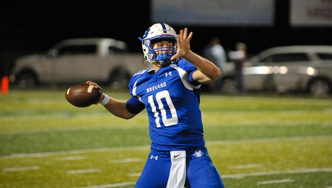 Tanner Ellenberger throws a pass for Brevard in Friday's 23-17 home win over Pisgah.