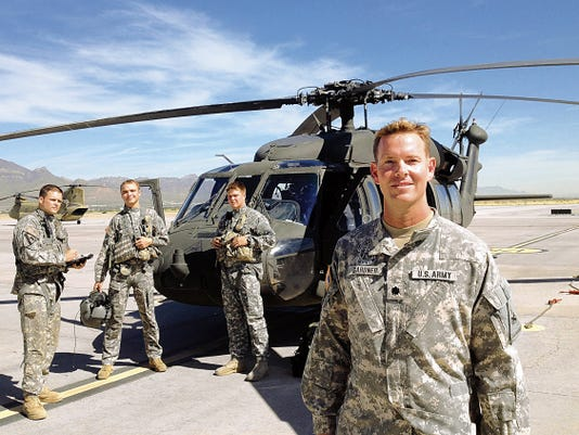 Lt. Col. Whitney B. Gardner, commander of the 2nd Battalion, 501st Aviation Regiment, stands with members of Alpha Company, from left, company commander Capt. Jeffrey Epps and crew chiefs Spc. Kyle Salchow and Pfc. Jacob Reeder. Alpha Company is the 1st Armored Division's only command aviation company.