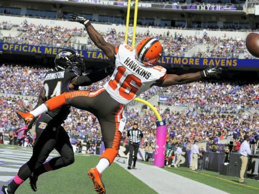 Cleveland Browns wide receiver Andrew Hawkins (16) misses a pass over Baltimore Ravens cornerback Kyle Arrington (24) during the second quarter on Sunday at M&T Bank Stadium in Baltimore.
