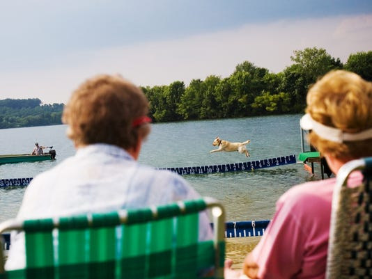 Iva Shearer of Seven Valleys, left, and Virginia Jones of Hanover watch the Dock Dogs competition from the shore at Codorus Blast in 2014.