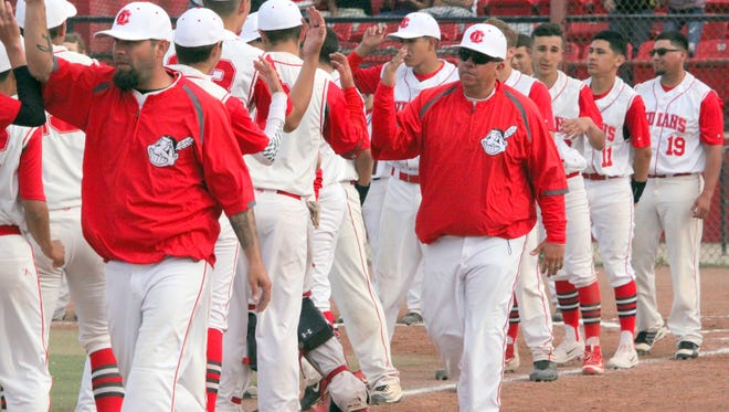 Cobre head coach Artie Sanchez, middle, does his pre-game ceremony of high fives during a game earlier this year. The Indians extended their season with a No. 14 seed in the state playoffs and a regional meeting with No. 3 St. Michael's on Friday.